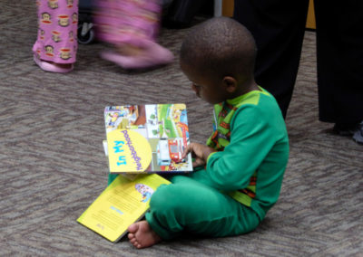 Boy looks at his new free books