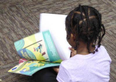 Child flipping through new free book